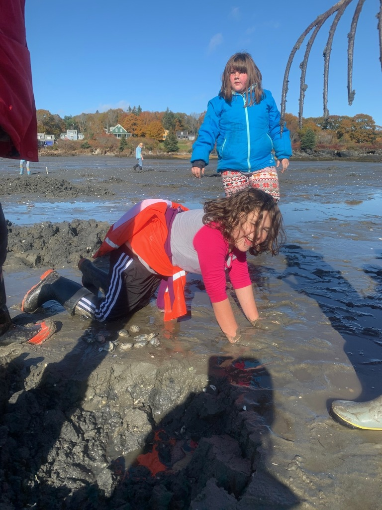 Emmie Pinkham finds some soft and salty mud to rejuvenate after a long afternoon of clamming !